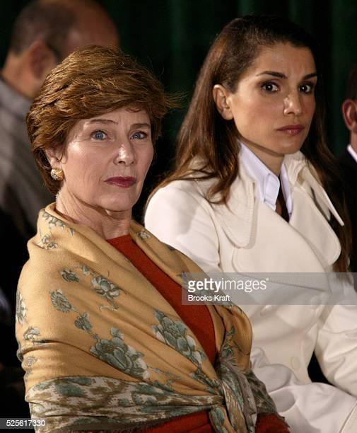 Jordan's Queen Rania and United States First Lady Laura Bush listen as United States President George W Bush and Jordan's King Abdullah II speak...