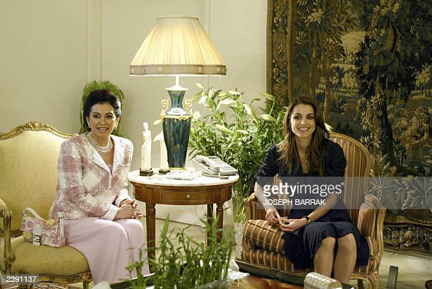 Jordan's Queen Rania meets 15 June 2003 with the wife of Lebanese Prime Minister Naziq Rafiq Hariri at the Baabda Presidential Palace near Beirut The...