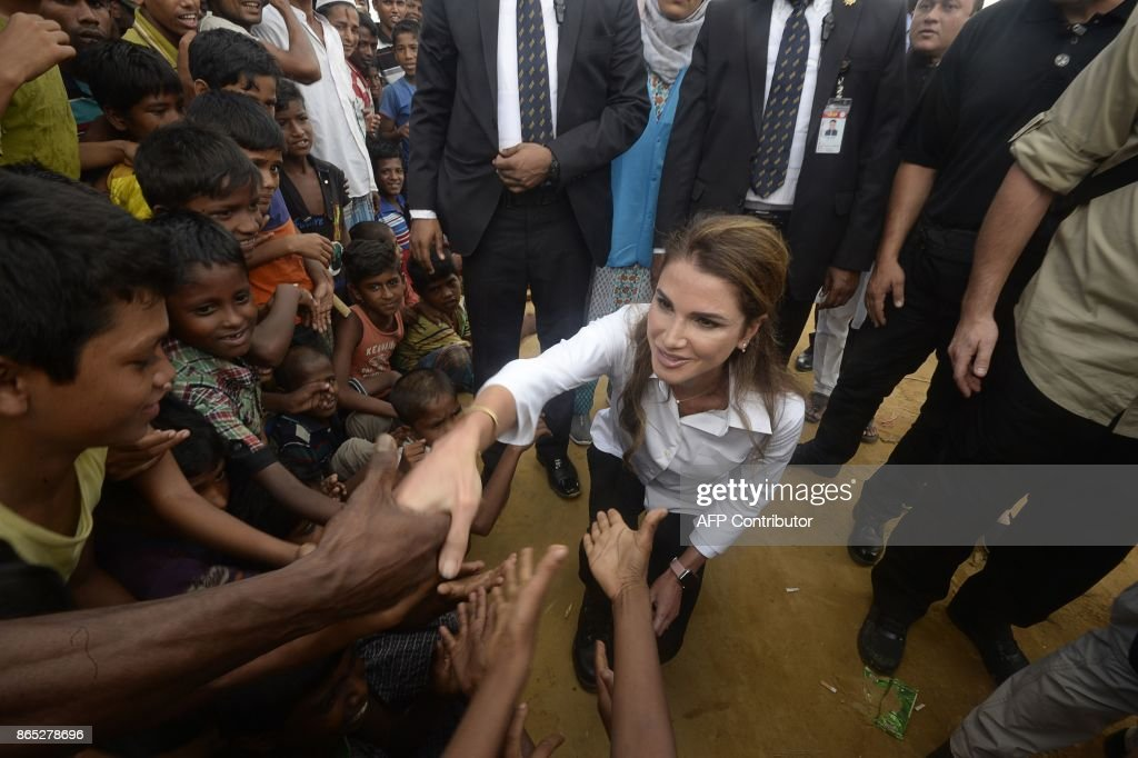 Jordan's Queen Rania meets with Rohingya refugees during her visit to the Kutupalong refugee camp in Ukhia on October 23, 2017. More than 600,000 Rohingya refugees have fled Myanmar for Bangladesh since violence erupted in northern Rakhine in August, a UN report said October 22. The grim new landmark comes as authorities in Bangladesh were bracing for another possible surge in Rohingya arrivals, with thousands from the Muslim minority believed to be stranded along the border waiting to cross. MUSTAFA