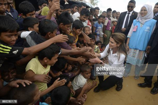 Jordan's Queen Rania meets with Rohingya refugees during her visit to the Kutupalong refugee camp in Ukhia on October 23 2017 More than 600000...