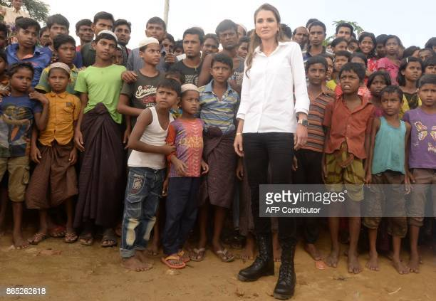 Jordan's Queen Rania poses with Rohingya refugee children and youths during her visit to the Kutupalong refugee camp in Ukhia on October 23 2017 More...