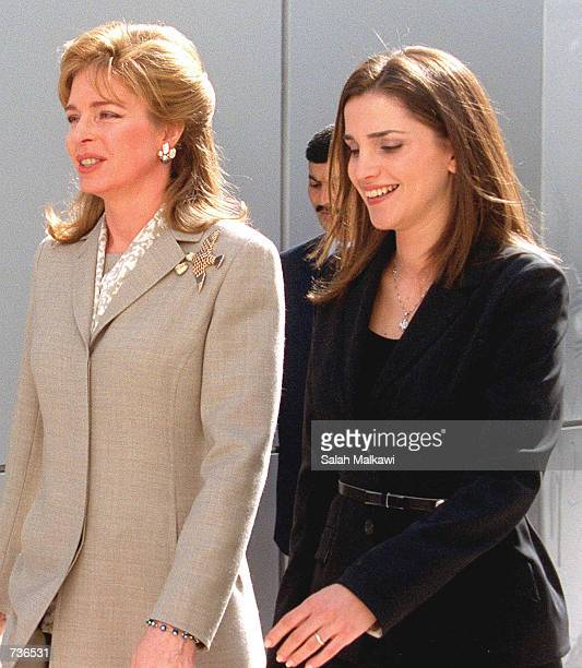 Jordan's Queen Rania right and Queen Noor wife of the late King Hussein chat as they leave for a memorial for the late King Hussein after attending...