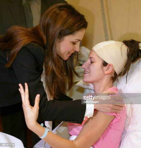 Jordan's Queen Rania visits a victim of the terrorist hotel bombings November 12 2005 in Amman Jordan Fiftyseven people are reported to have been...