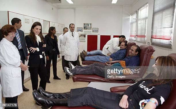 Jordan's Queen Rania visits people donating blood for the victims of the terrorist hotel bombings November 12 2005 in Amman Jordan Fiftyseven people...
