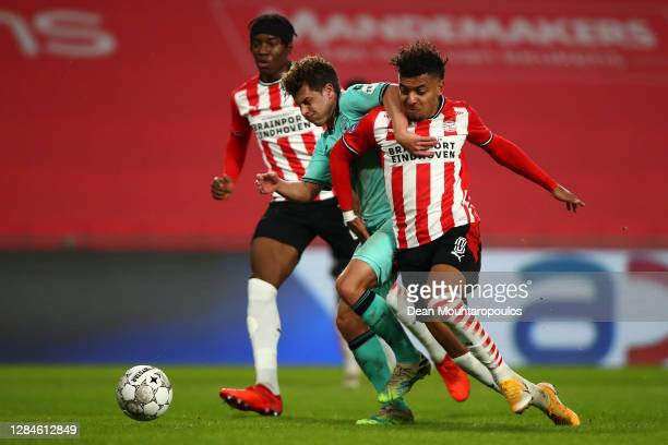 Jordens Peters of Willem II battles for the ball with Donyell Malen and Noni Madueke of PSV during the Dutch Eredivisie match between PSV Eindhoven...