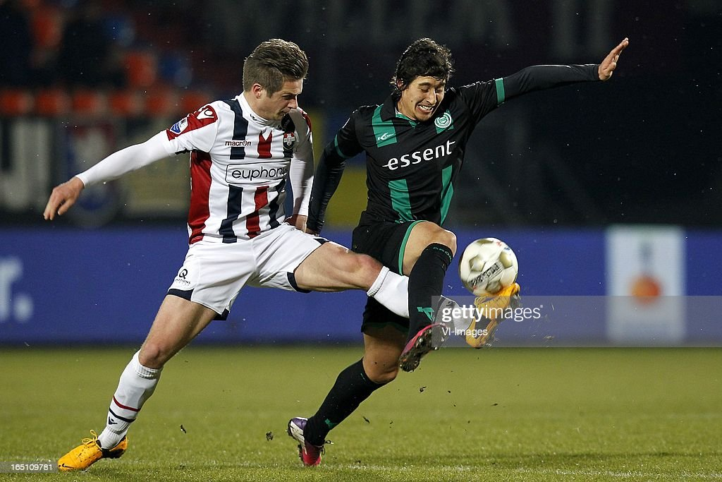 Jordens Peters of Willem II (L), David Texeira of FC Groningen (R) during the Dutch Eredivisie match between Willem II and FC Groningen at the Koning Willem II Stadium on march 30, 2013 in Tilburg, The Netherlands