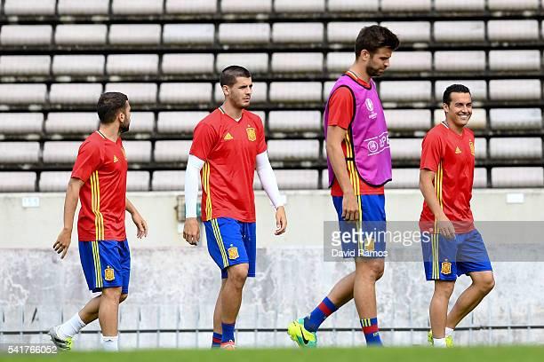 Jordi Alba Alvaro Morata Gerard Pique and Pedro Rodriguez of Spain look on during a training session ahead of their UEFA Euro 2016 Group D match...