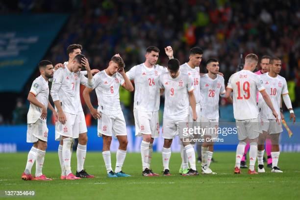 Jordi Alba, Alvaro Morata, Pau Torres, Marcos Llorente, Aymeric Laporte, Gerard Moreno, Rodri, Pedri, Dani Olmo and Thiago Alcantara of Spain react...