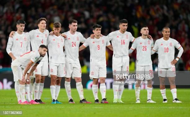 Jordi Alba, Alvaro Morata, Pau Torres, Marcos Llorente, Aymeric Laporte, Gerard Moreno, Rodri, Pedri and Thiago Alcantara of Spain look dejected...