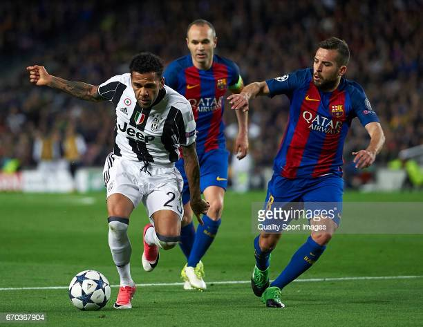 Jordi Alba and Andres Iniesta of Barcelona competes for the ball with Daniel Alves of Juventus during the UEFA Champions League Quarter Final second...