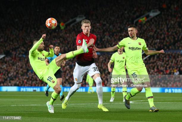 Jordi Alba and Clement Lenglet of FC Barcelona tackle Scott McTominay of Manchester United during the UEFA Champions League Quarter Final first leg...