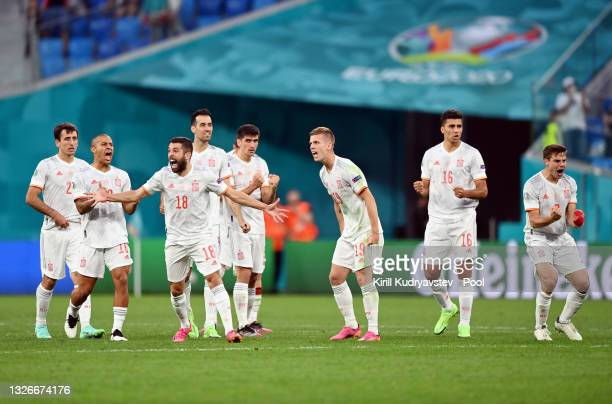 Jordi Alba and Dani Olmo of Spain celebrate with team mates during the penalty shoot out during the UEFA Euro 2020 Championship Quarter-final match...