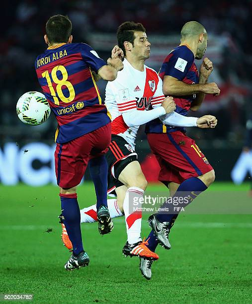 Jordi Alba and Javier Mascherano of Barcelona challenge for the ball with Rodrigo Mora of River Plate during the FIFA Club World Cup Final match...