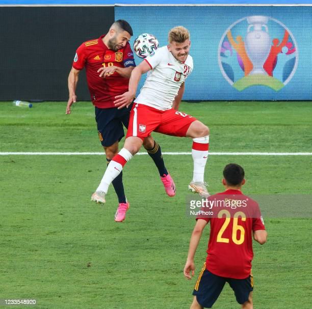Jordi Alba and Kamil Jozwiak in action during the UEFA EURO 2020 Group E football match between Spain and Poland at La Cartuja Stadium in Seville,...