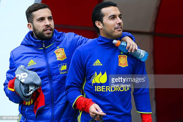 Jordi Alba and Pedro Rodriguez of Spain walk onto the pitch during an international friendly match between Spain and Korea at the Red Bull Arena...