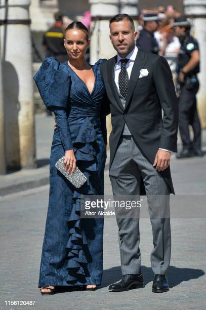 Jordi Alba and Romarey Ventura attend the wedding of real Madrid football player Sergio Ramos and Tv presenter Pilar Rubio at Seville's Cathedral on...