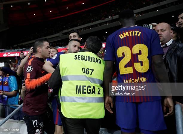 Jordi Alba and Samuel Umtiti talk with security members after Copa del Rey Final soccer match between Sevilla and Barcelona at Wanda Metropolitano...