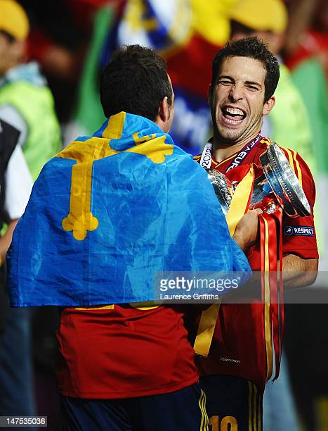 Jordi Alba and Santi Cazorla of Spain celebrate with the trophy following their team's victory during the UEFA EURO 2012 final match between Spain...