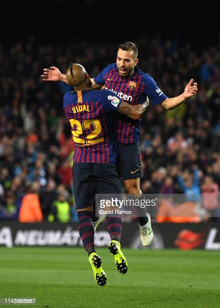 Jordi Alba celebrates with Arturo Vidal of Barcelona after scoring his sides second goal during the La Liga match between FC Barcelona and Real...