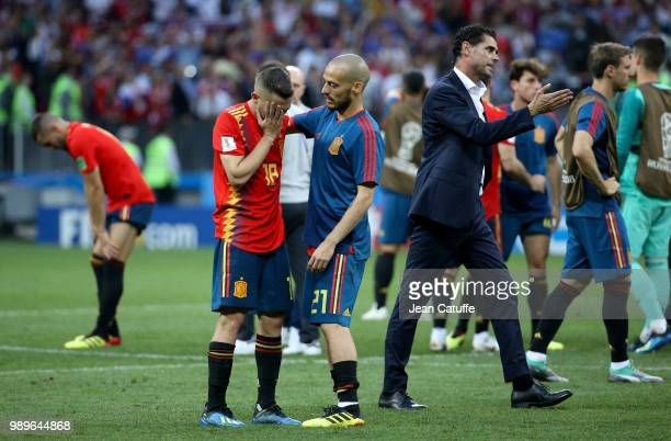 Jordi Alba David Silva coach of Spain Fernando Hierro dejected following the 2018 FIFA World Cup Russia Round of 16 match between Spain and Russia at...