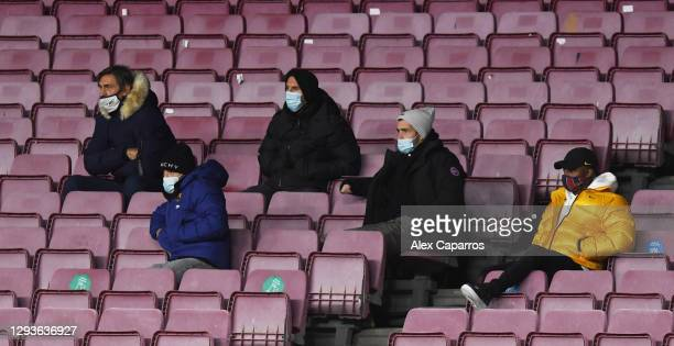 Jordi Alba, Lionel Messi, Sergi Roberto and Anssumane 'Ansu' Fati of Barcelona watch from the stands during the La Liga Santander match between FC...