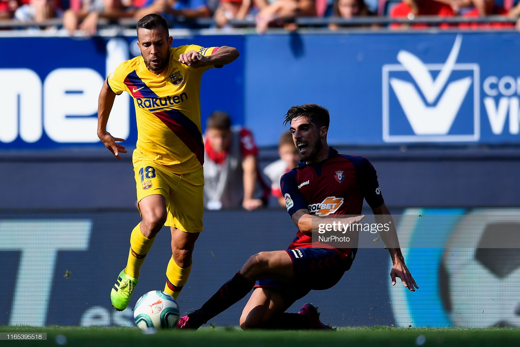 صور مباراة : أوساسونا - برشلونة 2-2 ( 31-08-2019 )  Jordi-alba-of-barcelona-and-nacho-vidal-of-osasuna-competes-for-the-picture-id1165395518?s=2048x2048