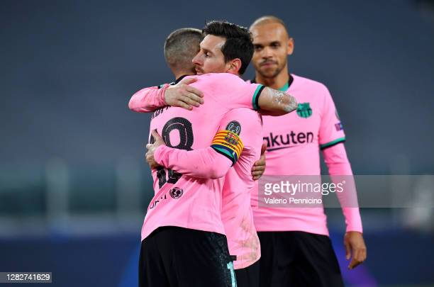 Jordi Alba of Barcelona and team mate Lionel Messi embrace during the UEFA Champions League Group G stage match between Juventus and FC Barcelona at...