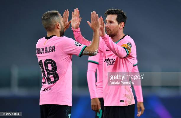 Jordi Alba of Barcelona and team mate Lionel Messi high five during the UEFA Champions League Group G stage match between Juventus and FC Barcelona...
