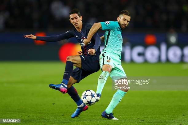 Jordi Alba of Barcelona battles for the ball with Angel Di Maria of Paris SaintGermain during the UEFA Champions League Round of 16 first leg match...