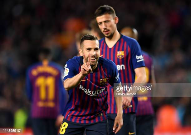 Jordi Alba of Barcelona celebrates after scoring his sides second goal during the La Liga match between FC Barcelona and Real Sociedad at Camp Nou on...