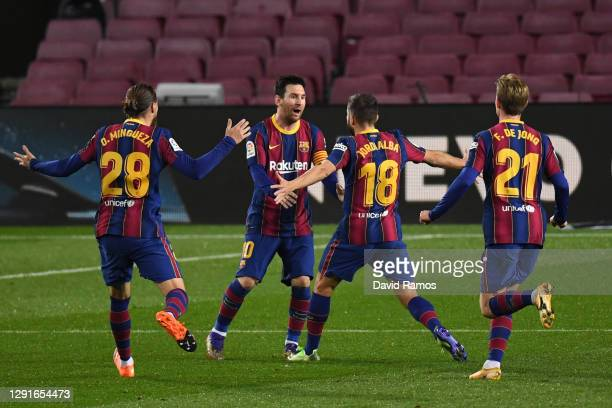 Jordi Alba of Barcelona celebrates after scoring their team's first goal with Oscar Mingueza, Lionel Messi, and Frenkie de Jong of Barcelona during...
