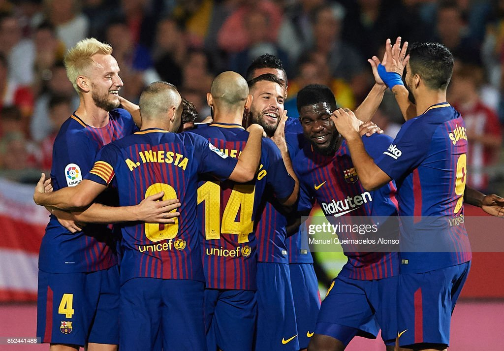Jordi Alba of Barcelona celebrates scoring his team's first goal with his teammates during the La Liga match between Girona and Barcelona at Municipal de Montilivi Stadium on September 23, 2017 in Girona, Spain.