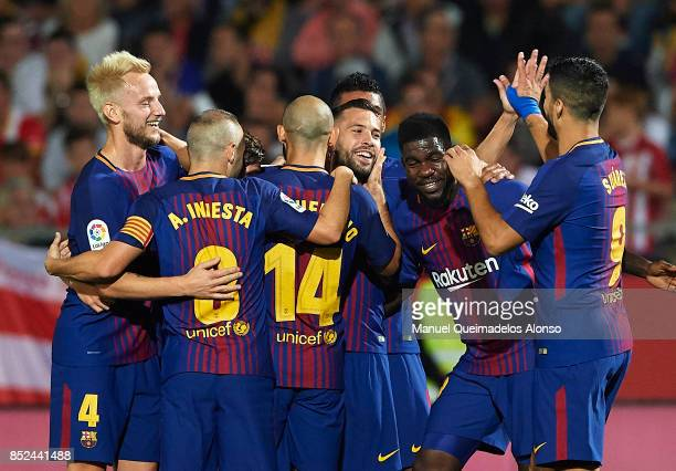 Jordi Alba of Barcelona celebrates scoring his team's first goal with his teammates during the La Liga match between Girona and Barcelona at...