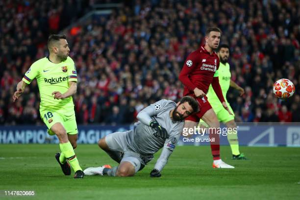 Jordi Alba of Barcelona is foiled by Alisson of Liverpool during the UEFA Champions League Semi Final second leg match between Liverpool and...