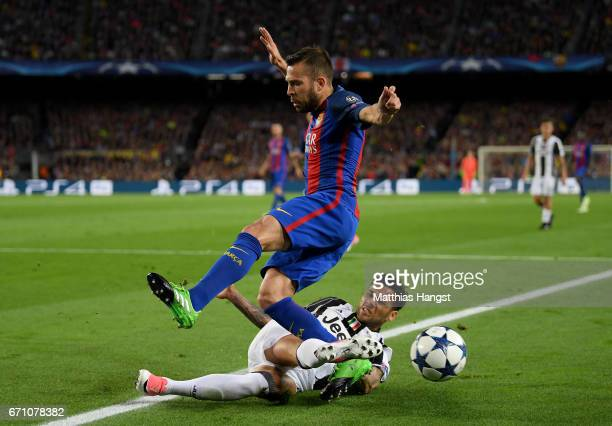 Jordi Alba of Barcelona is tackled by Dani Alves of Juventus during the UEFA Champions League Quarter Final second leg match between FC Barcelona and...