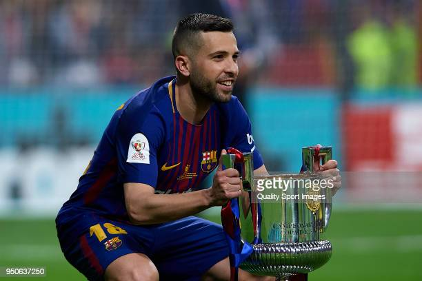 Jordi Alba of Barcelona poses with the trophy after winning the Spanish Copa del Rey Final match between Barcelona and Sevilla at Wanda Metropolitano...