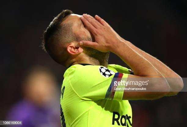 Jordi Alba of Barcelona reacts after missing a chance during the UEFA Champions League Group B match between PSV Eindhoven and FC Barcelona at...