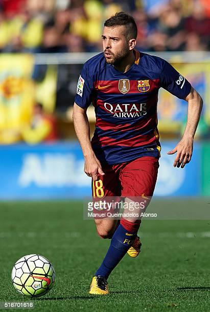 Jordi Alba of Barcelona runs with the ball during the La Liga match between Villarreal CF and FC Barcelona at El Madrigal on March 20 2016 in...