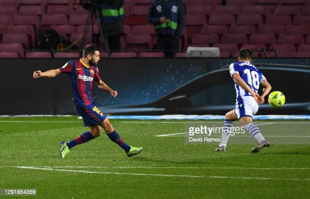Jordi Alba of Barcelona scores their team's first goal during the La Liga Santander match between FC Barcelona and Real Sociedad at Camp Nou on...