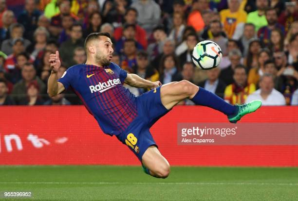 Jordi Alba of Barcelona stretches for the ball during the La Liga match between Barcelona and Real Madrid at Camp Nou on May 6 2018 in Barcelona Spain