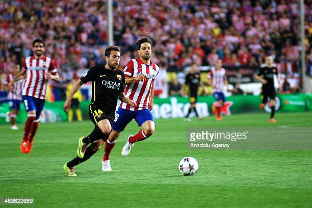 Jordi Alba of Barcelona vies for the ball with Diego Ribas da Cunha of Atletico Madrid during the UEFA Champions League quarterfinal second leg...