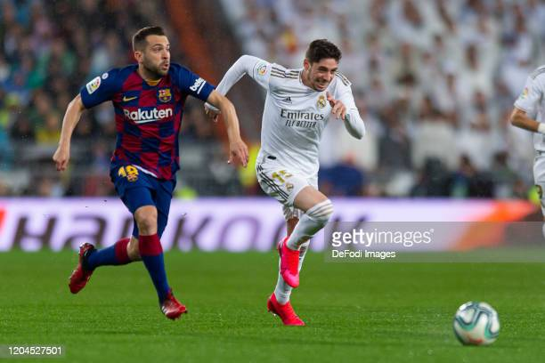 Jordi Alba of FC Barcelona and Federico Valverde of Real Madrid battle for the ball during the Liga match between Real Madrid CF and FC Barcelona at...