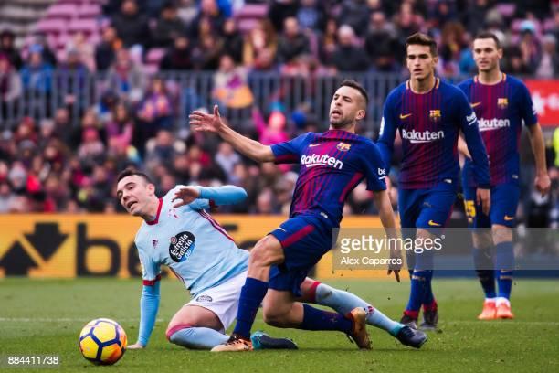 Jordi Alba of FC Barcelona and Iago Aspas of Celta de Vigo compete for the ball during the La Liga match between FC Barcelona and Celta de Vigo at...