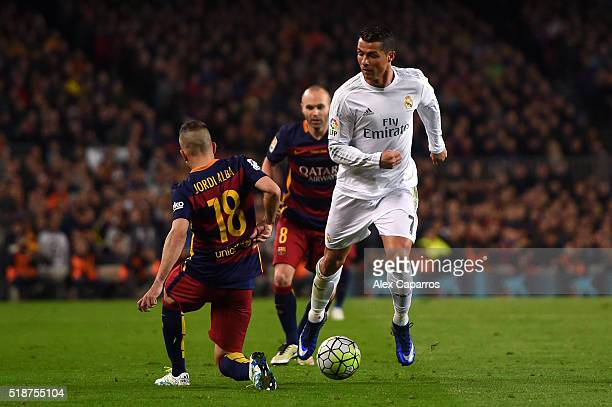 Jordi Alba of FC Barcelona battles for the ball with Cristiano Ronaldo of Real Madrid CF during the La Liga match between FC Barcelona and Real...