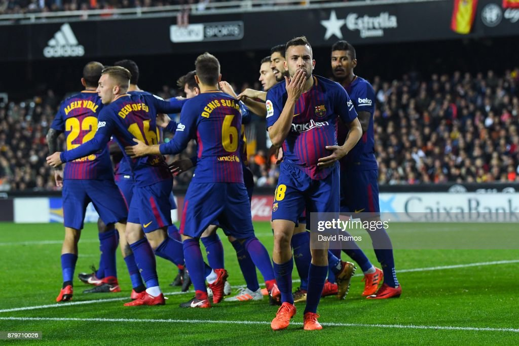 Jordi Alba of FC Barcelona celebrates after scoring his team's first goal during the La Liga match between Valencia and Barcelona at Mestalla stadium on November 26, 2017 in Valencia, Spain.