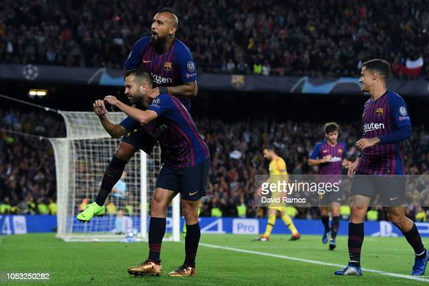Jordi Alba of FC Barcelona celebrates with his team mate Arturo Vidal after scoring his team's second goal during the Group B match of the UEFA...