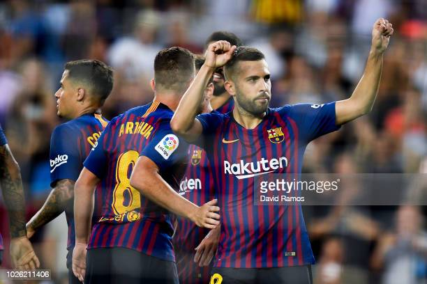 Jordi Alba of FC Barcelona celebrates with his team mates after scoring his team's seventh goal during the La Liga match between FC Barcelona and SD...
