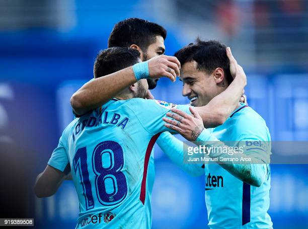 Jordi Alba of FC Barcelona celebrates with his teammates Philippe Coutinho and Luis Suarez of FC Barcelona after scoring his team's second goal...