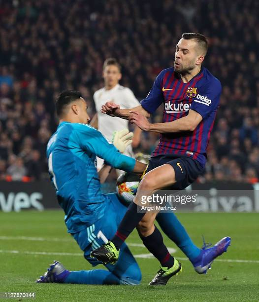 Jordi Alba of FC Barcelona clashes with Keylor Navas of Real Madrid CF during the Copa del Semi Final first leg match between Barcelona and Real...
