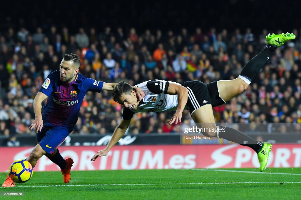Jordi Alba of FC Barcelona competes for the ball with Gabriel Paulista of Valencia CF during the La Liga match between Valencia and Barcelona at Mestalla stadium on November 26, 2017 in Valencia, Spain.
